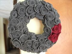 this wreath turned out very cute!  the rosettes are made from a felted wool skirt (goodwill, 3.29) and a scrap of red felt.  The wreath was on sale for 2.00.  Two hours later and I had a really neat decorating piece (of course it wasn't for me, but you know what I mean!)