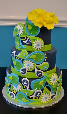 - Paisley Cake--dummy cake covered in fondant and accented with blue, green, and white paisleys. Gumpaste flower on top :) Thanks for looking!
