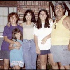 Selena posing with people from her neighborhood..