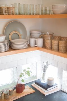 """They kept some block glass in one corner of the kitchen, but replaced the Art Deco backsplash with white subway tile and gray grout """"to keep it classic and light."""""""