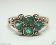 ANTIQUE ART DECO DIAMOND FILIGREE ENGAGEMENT RING RE-549   {International Buyers Are Responsible For Customs & Duty Fees}  CIRCA ~ 1900's  4 ROUND COLOMBIAN EMERALDS   SIZE ~ 1 CARAT TOTAL WEIGHT   COLOR ~ MEDIUM GREEN  4 ROSE CUT DIAMONDS ~ .04 CARAT  COLOR ~ K - M   CLARITY ~ SI 1 - SI 2  FINGER SIZE ~ 7  (SIZABLE) U.S.A. & CANADA (Inquire About Sizing Cost)  (N1/2) UNITED KINGDOM, IRELAND, AUSTRALIA & NEW ZEALAND