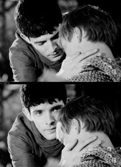 Merlin checking his pulse... and then having to stop himself thinking dirty thoughts. lol! That's what it looks like, anyway.