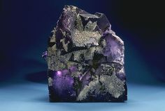 Fluorite (also called fluorspar) is a halide mineral composed of calcium fluoride.  The word fluorite is derived from the Latin root fluo, meaning a stream or flow of water, because the mineral has been traditionally been used as a flux.