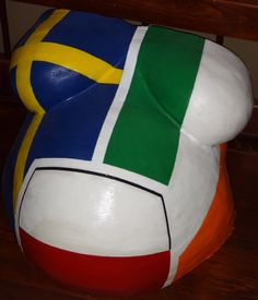 Dad is Swedish and Polish, mom is Irish and Polish so they mixed the three flags to represent baby's heritage.