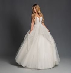 Style 1959 Nahla Blush by Hayley Paige bridal gown - Ivory sugar rose caviar ball gown, plunging sweetheart neckline with illusion net insert, low scoop back with cross strap detail, cascading caviar tiered skirt with tulle underlay. Hayley Paige Bridal, Blush By Hayley Paige, Tulle Ball Gown, Ball Gowns, Wedding Dress Sizes, Gown Wedding, Dream Wedding, Klienfeld Wedding Dresses, Wedding Stuff