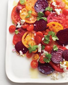 Tomato-Beet Salad from Martha Stewart,  Yummy use of tomatoes that are in season.  I love beets and they have a great tip for cooking and removing the peel.  No more red hands when peeling beets!  YUM!