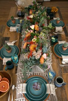 Burnt orange and a soft turquoise table scale mixed with live plants and terracotta pots. Table Settings, Place Settings, Table Arrangements, Desk Layout