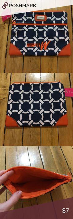 """NWT Limited edition Ame and Lulu ESPNW makeup bag NWT limited edition Ame and Lulu for ESPNW makeup bag with orange/blue/white pattern and orange lining. Zipper closure. Approximately 8x7"""". Like the item but not the price? Message me with best offers or bundle requests, and we can try to work something out. Ame and Lulu Bags Cosmetic Bags & Cases"""
