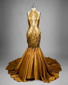 its very old and very valuable and very beautiful just like you... so i would like to give it to you as a gift gold stared at the dress glossy eyed and totally speechless