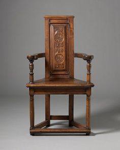 French Renaissance Caquetoire.  This is a more ornamented example of the French caquetoire (gossip) chair.  This chair is made of walnut, has the typical high back with stretchers at the floor.  However, this example has an ornamented carved splat.