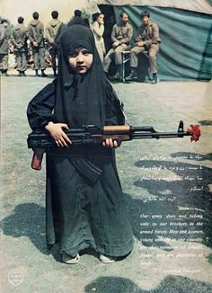 Iranian Girl With Gun - i like her flower :)