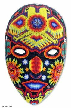Beadwork mask, 'Duality of the Gods' by NOVICA. $147.99. Keep out of heat. Keep out of the sun. Handmade by Higinio Hernandez Carrillo. Normally ships directly from Mexico within 10 days.. A fair trade product. NOVICA, in association with National Geographic, searches the world to work directly with the finest artisan designers. The world explodes and opens into a hypnotic path of blazing color and Huichol design. The spirit of Kawauyomaire the blue deer holds reign ov...