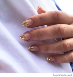 Nails with gold gliter tips