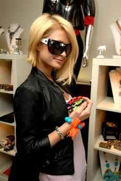 Paris in a floundering fish bracelet, and our original car bracelet #parishilton #cars #Celebrities #bracelets
