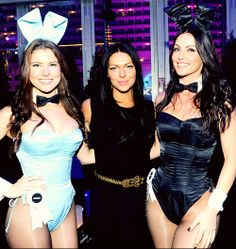 Laura Prepon poses with Playboy Bunnies during The Playboy Party at The Bud Light Hotel Lounge, Jan 31, 2014
