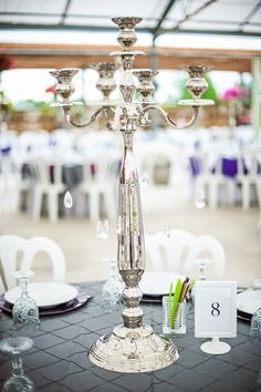 LACEY & RYAN'S WEDDING! JUNE 21, 2013 Photo By Kate Maxwell Photography. Half the tables had these candelabras with crystals, half had silver vases with curly willow and walking stick branches.  There are 3 different table cloth colors and several combinations of napkins and chargers.  I couldn't decide so I chose all three colors.