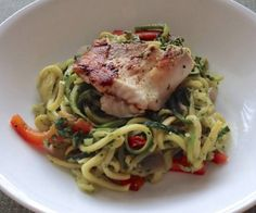 Zucchini and summer squash noodles with a skinny pesto sauce, topped with grilled tilapia.