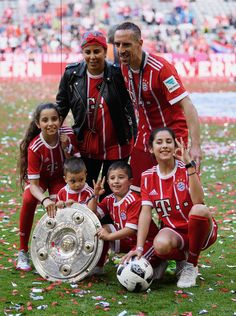 Franck Ribery of FC Bayern Muenchen celebrates with his family after winning the 67th German Championship title following the Bundesliga match between Bayern Muenchen and SC Freiburg at Allianz Arena on May 20, 2017 in Munich, Germany.