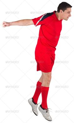 Fit football player jumping up on white background ...  30s, Mid Adult, activity, attractive, caucasian, cut out, football, gear, handsome, isolated, jumping, leaping, male, man, player, playing, red, soccer, sport, sportsman, sportswear