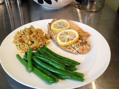 Ripped Recipes - Lemon Tilapia Baked In Foil With Asparagus and Couscous - This is a fool proof way of cooking fish, it tastes awesome, it's always moist and takes no time at all to prepare, give it a try!