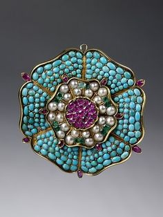 1830-1849 brooch in the form of a Tudor rose:  gold, pavé-set with turquoises, rubies, emeralds, and pearls, probably made in England.