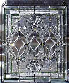 More properly known as leaded glass, as there are no colors in this. Pretty light catcher probably creates a few rainbows.