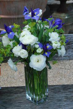 white ranunculus, iris, and bupleurum