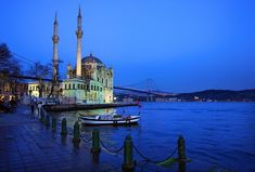 'Ortaköy & the first bridge of Bosphorus' by Hercules Milas – travel outfit plane Bosphorus Bridge, Hunter Boats, Chelsea Brown, Winter Crops, Like Image, Boating Outfit, Christian Clothing, Hercules, Fishing Boats