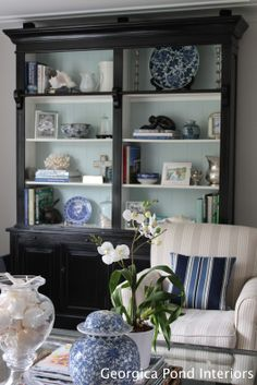 Black bookshelves with painted back (Benjamin Moore Palladian Blue)