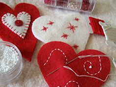 heart ornaments, embroidered details by FeltSewGood, via Flickr