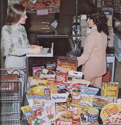 Vintage 1970s supermarket checkout with lots of products