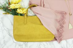 Add a pop of yellow to your Spring wardrobe! #yellowpurse #purse #tote #mustard #gold #handbag #boutique #springfashion #fashion #style #flatlay #outfit #pink #keyboutique #shopkeyboutique