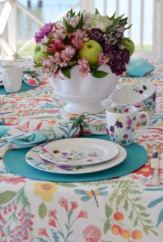 Kim Parker Mikasa Meadow Violets and colorblocked floral arrangement with alstroemeria, hydrangea, daisies and carnations, along with some Granny Smith apples | homeiswheretheboatis.net #tablescape #spring