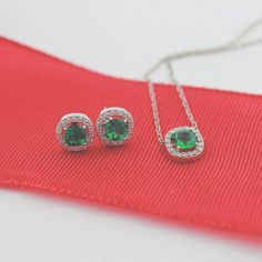 Check out these GORGEOUS Diamond Halo Emerald Cushion Earrings and Pendant!