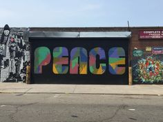 Public Street Art Thriving in Astoria, Queens // Welling Court 2015: Art by Icy and Sot (left), PEACE (center), John Brainier (right) (photo credit: Mary Alice Franklin)
