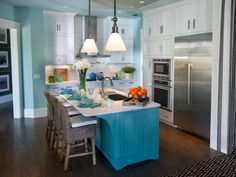 Just a short distance from the shore in Jacksonville, Fla., this HGTV Smart Home kitchen's watery color scheme certainly puts you in a vacation state of mind. Designer Linda Woodrum chose crisp white for the wall cabinets, quartz countertops and glass subway tile backsplash then painted the walls and ceiling in a soft teal. For the kitchen's hard-working island, she chose a more saturated turquoise.