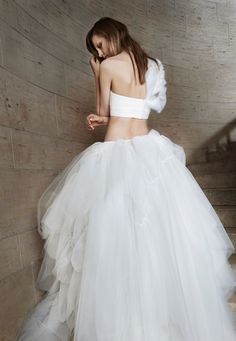 Vera Wang Spring 2015 Bridal Collection - Ivory strapless bra with hand  draped tulle detailing and organza flower technique. Ivory tulle ball gown  skirt ... 54cf3d49d21