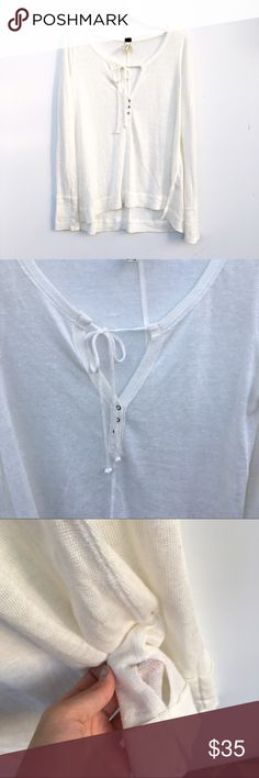 NWOT Free People Off White Henley Off white Free People tie front henley. Slit about an inch up on each side, slightly high low. Free People Tops Tees - Long Sleeve