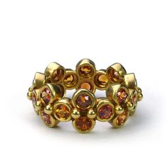 Sophisticated & Sassy Rings: 18K yellow gold, Etruscan Bead Ring with 3.5 carats of orange sapphires.
