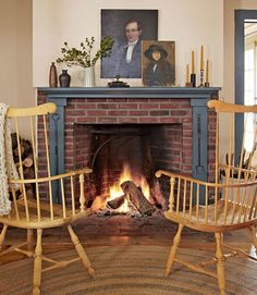 "Smith also researched the property's history at a local museum and archives. The couple rewired the electrical system, but replaced the midcentury toggles with push-button switches. Smith even hired a mason to create a 19th-century-style open fireplace. ""I made our last Thanksgiving turkey in there!"" In this photo: The Windsor chairs are from a vintage store in Hudson, New York. The throw is from Loopy Mango."