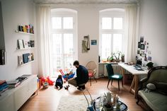 Vivien Weyrauch & Fabian Röttger, Music Video Director, Apartment, Kreuzberg, Berlin --- (It's nice to see a place that actually looks like someone lives there! With toys on the floor, etc.. Most house/apartment features look like hotel brochures, with nothing personal in sight..)