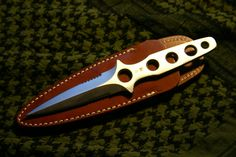 This is a classic skeleton style boot knife by Al Mar.