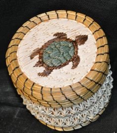 Beautiful hand woven birch bark basket adorned with porcupine quills and sweetgrass.  Curve Lake Reserve Ontario