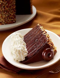The Cheesecake Factory's Black - Out Cake: Our richest chocolate cake with chocolate chips and chocolate cream cheese filling... Finished with toasted almonds and a dark chocolate wafer on top.