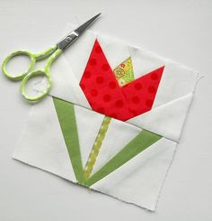 Block 132 - Bright Red Tulip. A lovely little paper pieced pattern by Daisy Mier Fredericks.