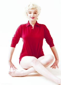 Marilyn. Red sweater sitting. Photo by Milton Greene, 1955.