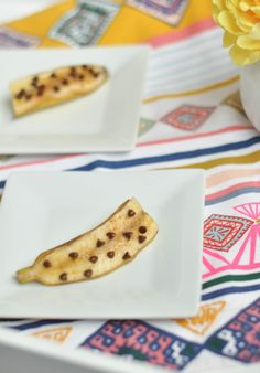 Simply cut your banana in half, sprinkle each half with cinnamon and mini chocolate chips. Roast at 350 degrees for 15 minutes in the peel. Yum!