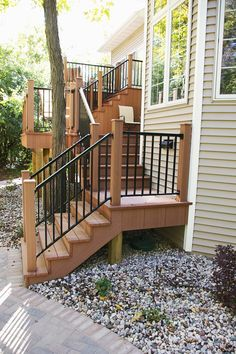 A tri-level deck, helps lead you from the upstairs main level to the backyard patio set in the woods. The Vande Hey Company, Inc.