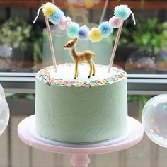 """Sometimes the simplest things are best! Loving this beautiful pastel mint birthday cake made lovingly by @stylishlittleparties and decorated with a pastel pom pom cake bunting made by @styledbybelle and the birthday girl's sweet little bambi figurine #pastelperfection #pompoms #confettiparty #mayas1stbirthday"" Photo taken by @styledbybelle on Instagram, pinned via the InstaPin iOS App! http://www.instapinapp.com (09/21/2015)"
