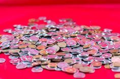 lot of romanian coins on a red background